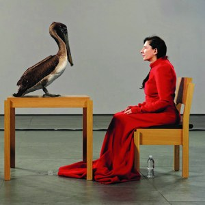 """The Brown Pelican Is Present (for Marina Abramovic)"" - Sittin' and starin' at people all day ain't nuttin'. Try keepin' da attention of a da state bird, da brown pelican, witout da help of a pocket full of chum. Louisiana Marina Abramovic has got dat in da hole. Now dats some art, T-Boog! I heard she trained wit da peoples from da Wildlife and Fisheries for months an she even had to pay $15 for a pelican handlin' license."